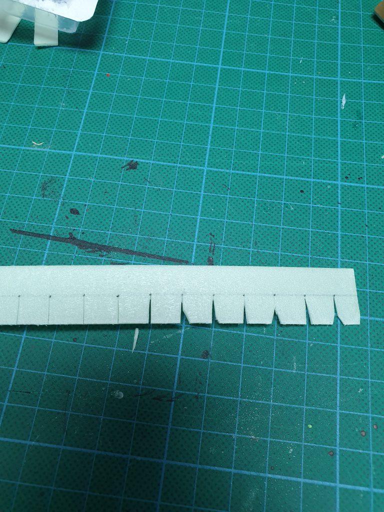 Een dak voorzien van dakshingles, stap 1 - shingles maken - stroken met shingles