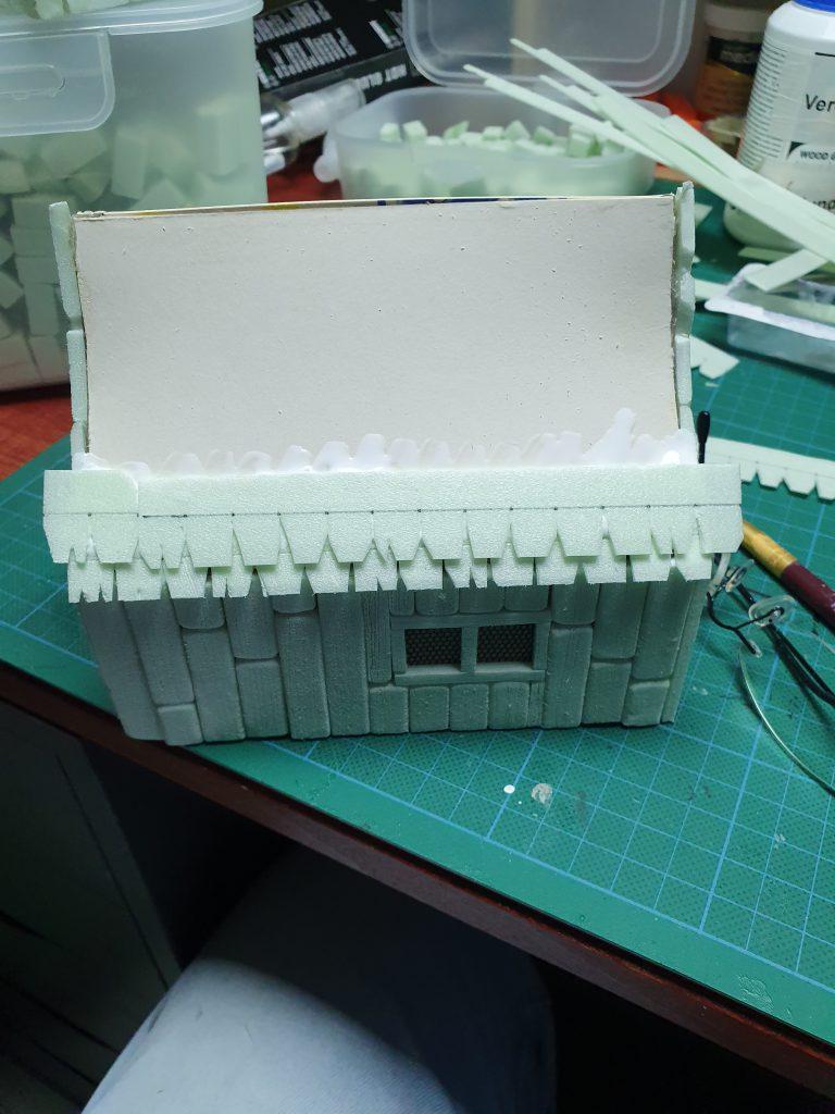 Een dak voorzien van dakshingles, stap 2 - shingles opplakken